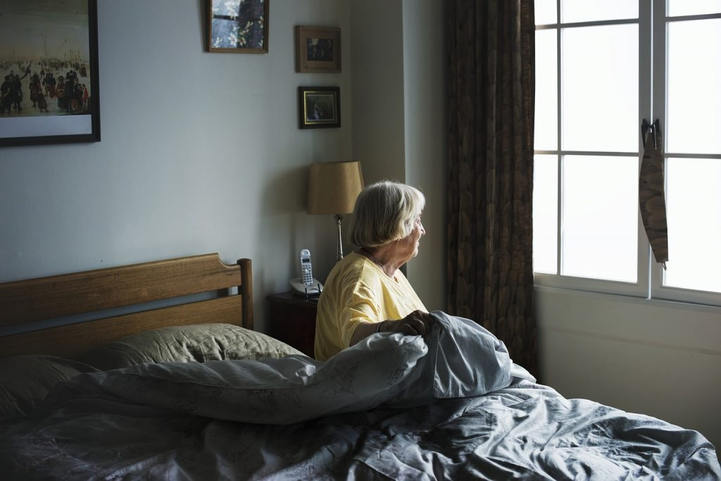 Image of elderly in bed for blog by Express Blinds and Curtains on curtains and blinds for accessible living